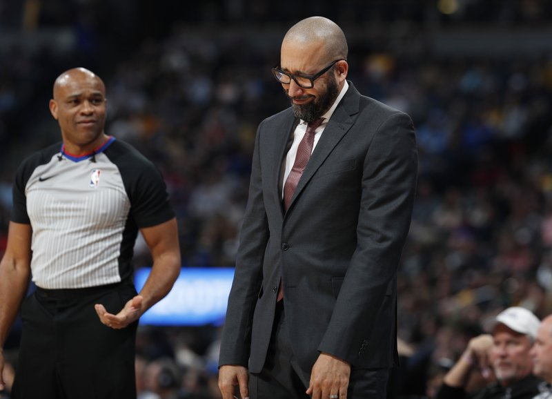 New York Knicks coach David Fizdale, right, looks down after arguing for a call with referee Tre Maddox during the first half of the team's NBA basketball game against the Denver Nuggets on Tuesday, Jan. (AP Photo/David Zalubowski)