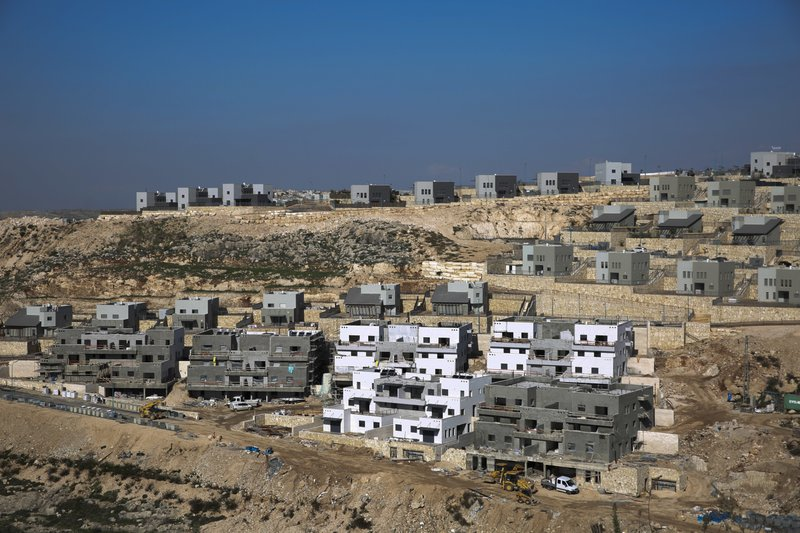 This Tuesday, Jan. 1, 2019 photo, shows a new housing project in the West Bank settlement of Naale. Data obtained by The Associated Press shows that the Israeli government -- with little resistance from a friendly White House -- has gone on a settlement push in the West Bank since President Donald Trump took office. (AP Photo/Ariel Schalit)