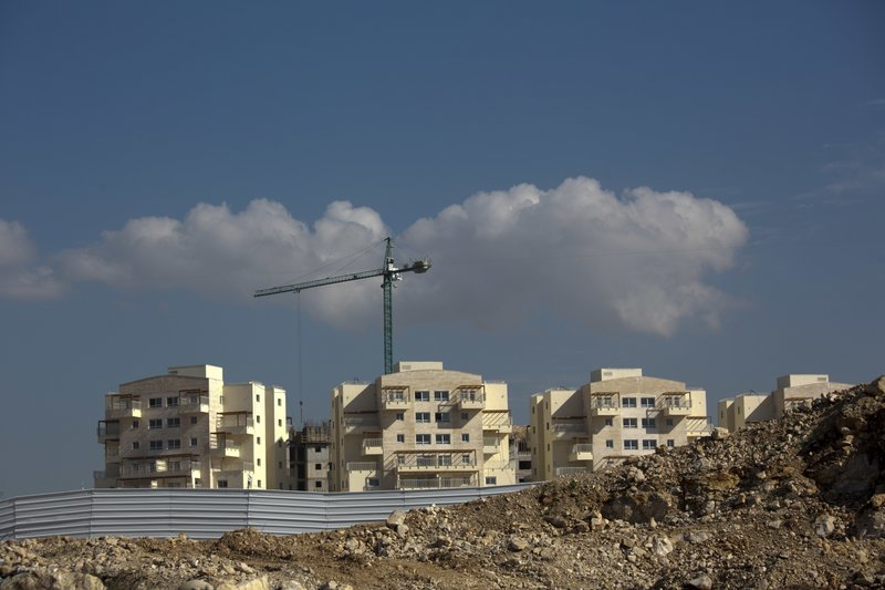 This Tuesday, Jan. 1, 2019 photo, shows a new housing project in a West Bank settlement of Modiin Ilit. (AP Photo/Ariel Schalit)