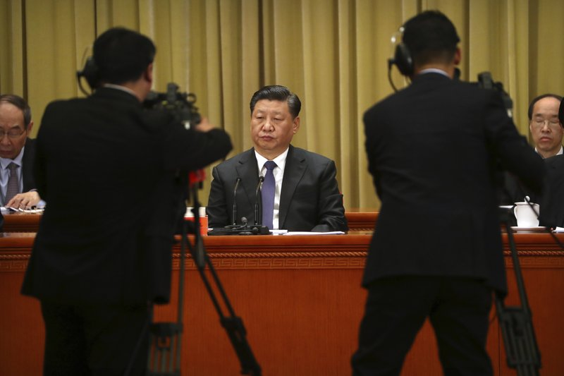 Chinese President Xi Jinping, center, listens to a speech during an event to commemorate the 40th anniversary of the Message to Compatriots in Taiwan at the Great Hall of the People in Beijing, Wednesday, Jan. (AP Photo/Mark Schiefelbein, Pool)