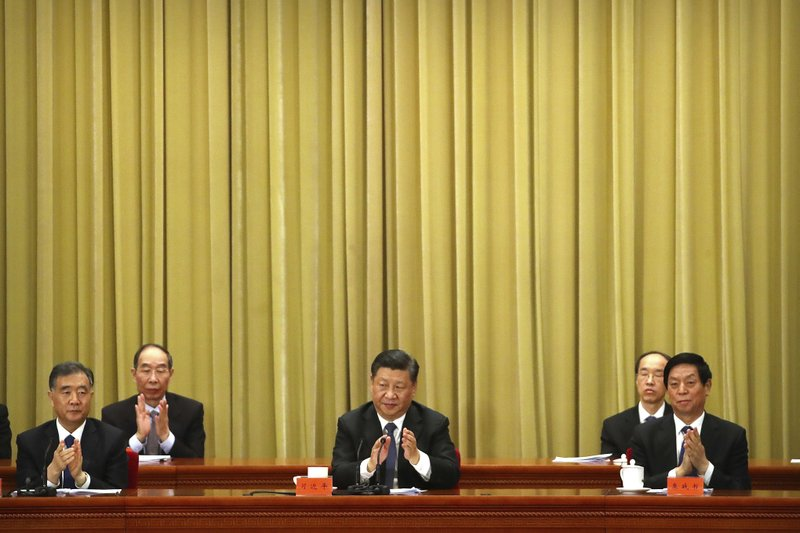 Chinese President Xi Jinping, center, applauds during an event to commemorate the 40th anniversary of the Message to Compatriots in Taiwan at the Great Hall of the People in Beijing, Wednesday, Jan. (AP Photo/Mark Schiefelbein, Pool)