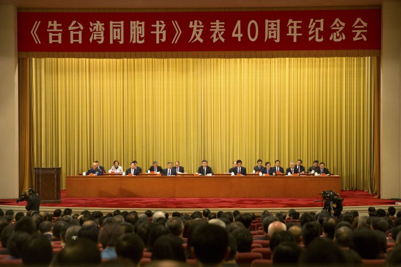 Chinese President Xi Jinping, center, speaks during an event to commemorate the 40th anniversary of the Message to Compatriots in Taiwan at the Great Hall of the People in Beijing, Wednesday, Jan. (AP Photo/Mark Schiefelbein, Pool)