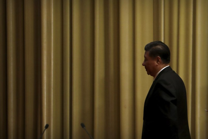 Chinese President Xi Jinping leaves following an event to commemorate the 40th anniversary of the Message to Compatriots in Taiwan at the Great Hall of the People in Beijing, Wednesday, Jan. (AP Photo/Mark Schiefelbein, Pool)