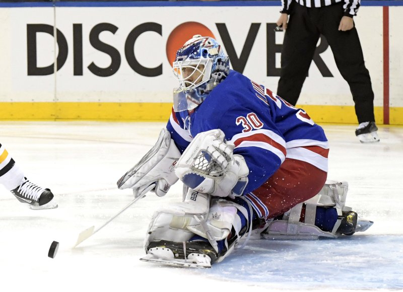 New York Rangers goaltender Henrik Lundqvist deflects the puck during the first period of an NHL hockey game against the Pittsburgh Penguins Wednesday, Jan. (AP Photo/Bill Kostroun)