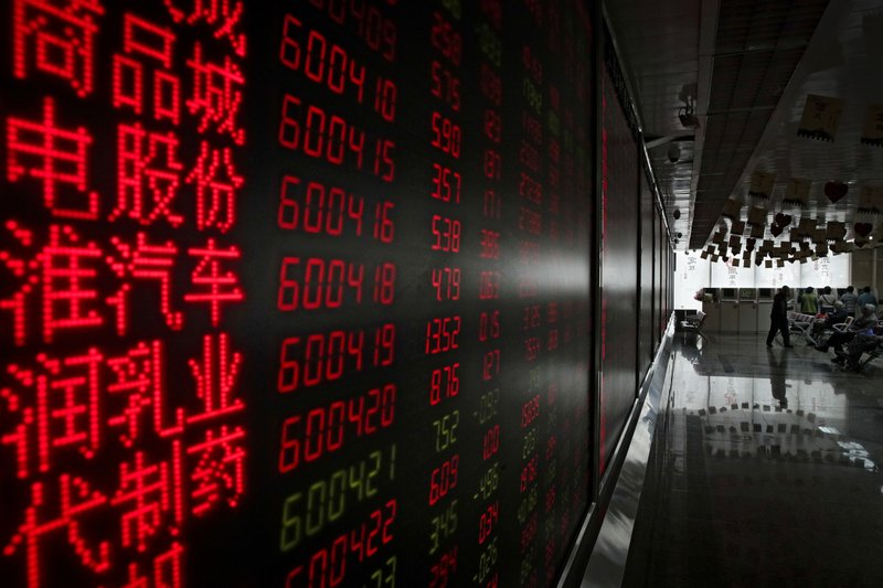 Investors monitor stock prices at a brokerage house in Beijing, Thursday, Jan. 3, 2019. Asian markets were mostly higher Thursday after tumbling more than 1 percent on the first trading day of 2019, as weaker-than-expected Chinese data exacerbated growth fears. (AP Photo/Andy Wong)