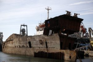 Greece hauls abandoned, half-sunken ships out of the sea
