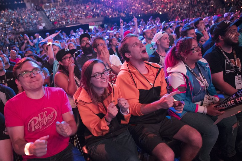 FILE - In this July 28, 2018 file photo, Philadelphia Fusion fans react as the London Spitfire takes the lead during the Overwatch League Grand Finals competition at Barclays Center in the Brooklyn borough of New York. (AP Photo/Mary Altaffer, File)