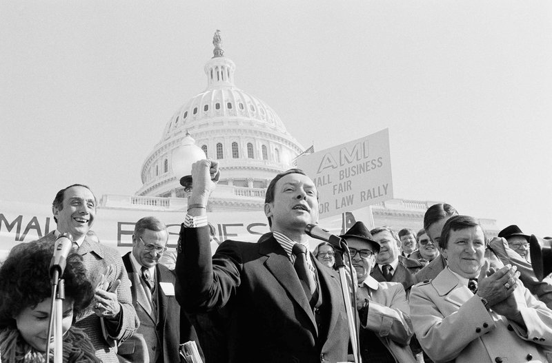 FILE - In this Sept. 15, 1982, file photo, Sen. Orrin Hatch, R-Utah, addresses a group from the Alliance of Metalworking industries on the steps of the Capitol in Washington. (AP Photo/File)