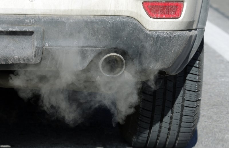 Exhaust comes from the tailpipe of a vehicle Thursday, Jan. 3, 2019, in Salt Lake City. Inversions hover over Salt Lake City as cold, stagnant air settles in the bowl-shaped mountain basins, trapping tailpipe and other emissions that have no way of escaping to create a brown, murky haze the engulfs the metro area. (AP Photo/Rick Bowmer)
