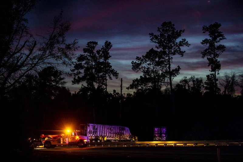 The sun sets over burned semi-trucks and vehicle debris after a wreck with multiple fatalities on Interstate 75, south of Alachua, near Gainesville, Fa. (Lauren Bacho/Star-Banner via AP)