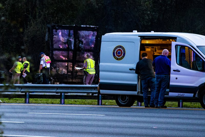 Police survey the scene after a wreck with multiple fatalities on Interstate 75, south of Alachua, near Gainesville, Fa. (Lauren Bacho/Star-Banner via AP)