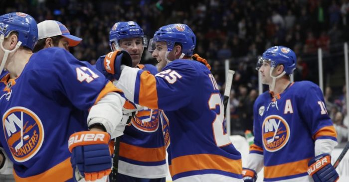 New York Islanders  Devon Toews celebrates with teammates after scoring the game  winning goal in the overtime period of an NHL hockey game Thursday 9373aaf21