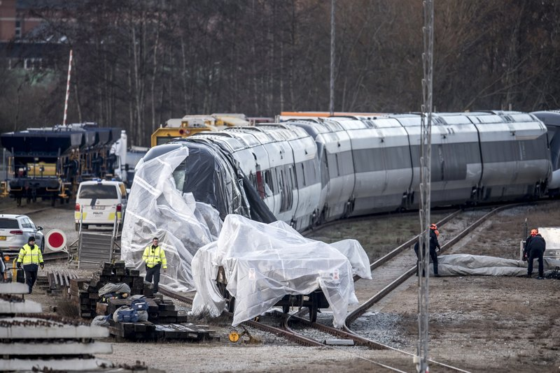 The train involved in the Wednesday morning accident is covered in Nyborg, Denmark, Thursday Jan. 3, 2019. (Mads Claus Rasmussen/Ritzau Scanpix via AP)