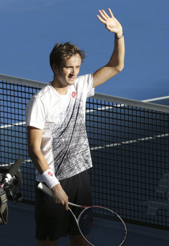 Daniil Medvedev of Russia waves at the crowd after he won his quarter final match against Milos Raonic of Canada at the Brisbane International tennis tournament in Brisbane, Australia, Friday, Jan. (AP Photo/Tertius Pickard)