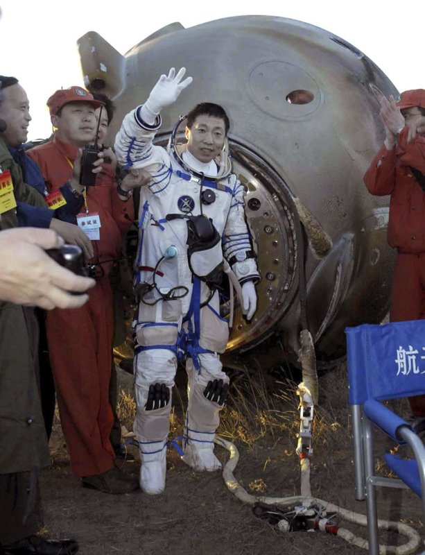 FILE - In this file photo taken Thursday, Oct. 16, 2003, China's first astronaut Yang Liwei waves after landing on the Inner Mongolian grasslands of northern China after 21 hours in orbit. (Xinhua via AP)