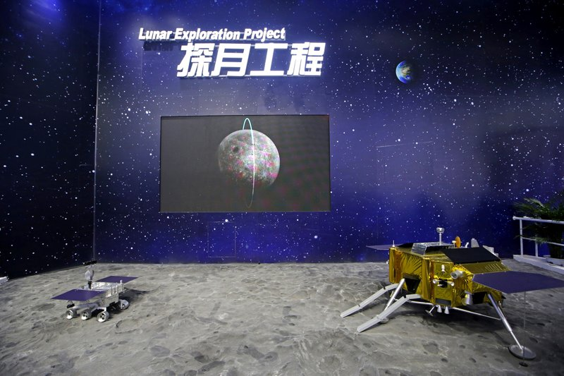 FILE - In this file photo taken Wednesday, Nov. 7, 2018, models of Chinese Chang'e IV Relay Satellite, right, and Lunar Probe Consists are displayed during the 12th China International Aviation and Aerospace Exhibition, also known as Airshow China 2018, in Zhuhai city, south China's Guangdong province. (AP Photo/Kin Cheung, File)