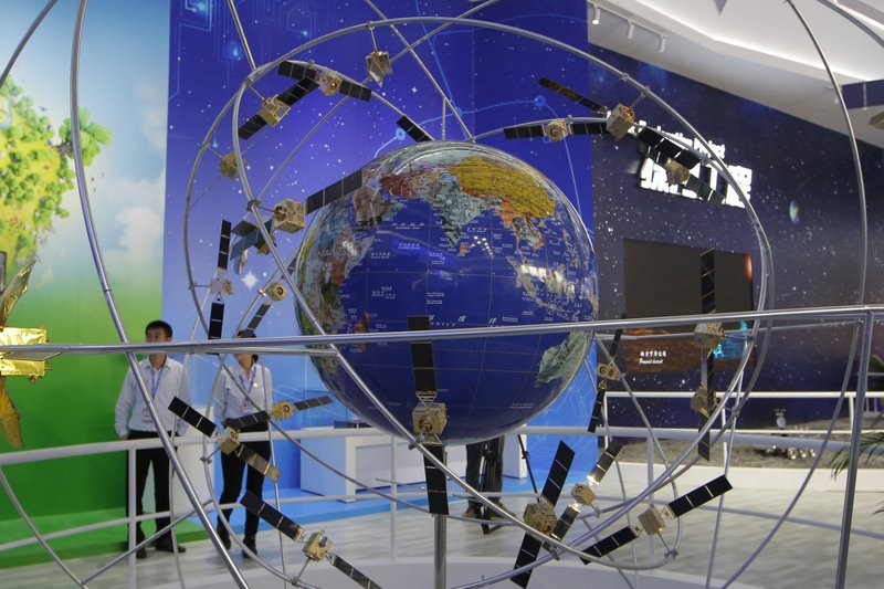 FILE - In this file photo taken Tuesday, Nov. 6, 2018, a model of Chinese BeiDou navigation satellite system is displayed during the 12th China International Aviation and Aerospace Exhibition, also known as Airshow China 2018, in Zhuhai city, south China's Guangdong province. (Global Positioning System). (AP Photo/Kin Cheung)