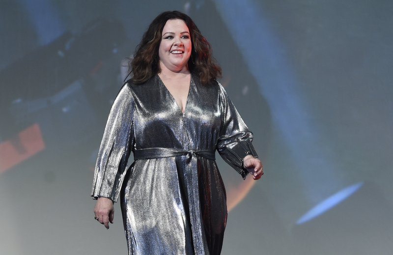 Melissa McCarthy walks on stage to accept the spotlight award actress for