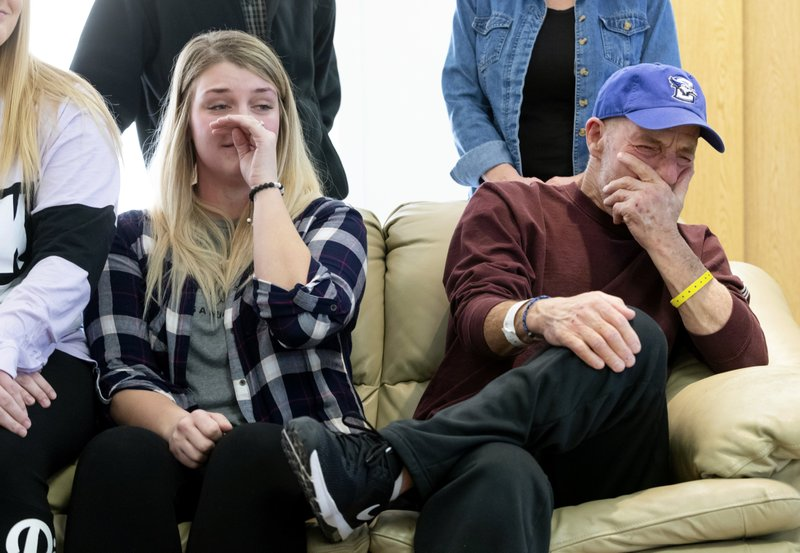 In this Thursday, Jan. 3, 2019 photo, T. Scott Marr and his daughter, Preston Marr, left, break down during a press conference in Omaha, Neb. (Kent Sievers/Omaha World-Herald via AP)