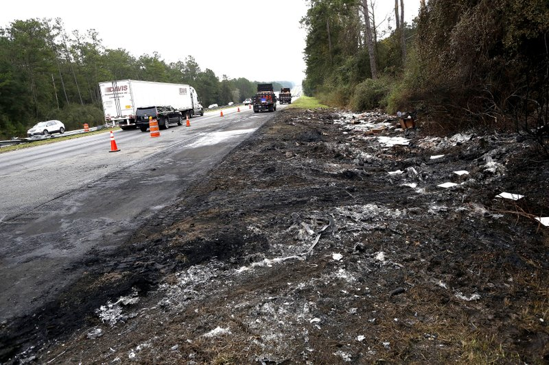 Debris off the south bound side of Interstate 75 remains at the scene of Thursday's multi-vehicle accident that caused multiple fatalities between Alachua and Gainesville, Fla. (Brad McClenny/The Gainesville Sun via AP)