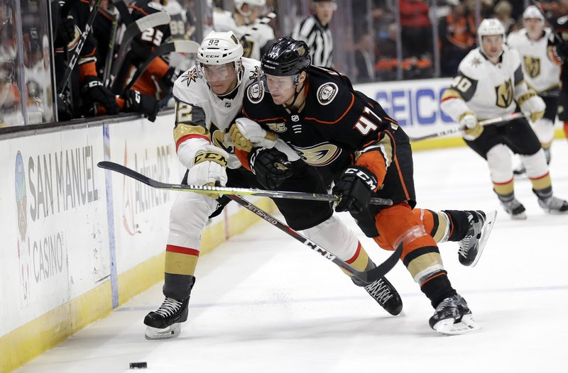 Vegas Golden Knights' Tomas Nosek, left, is defended by Anaheim Ducks' Hampus Lindholm during the first period of an NHL hockey game Friday, Jan. (AP Photo/Marcio Jose Sanchez)