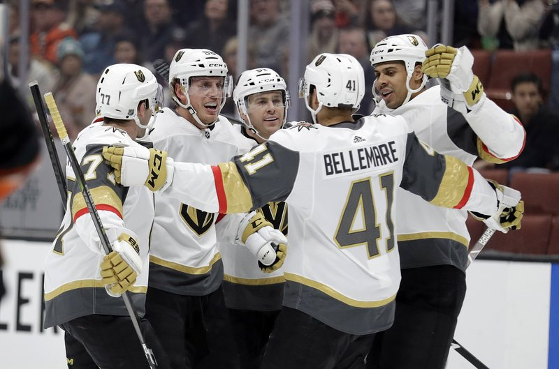 Vegas Golden Knights' Nate Schmidt, second from left, celebrates his goal with teammates during the first period of an NHL hockey game against the Anaheim Ducks on Friday, Jan. (AP Photo/Marcio Jose Sanchez)