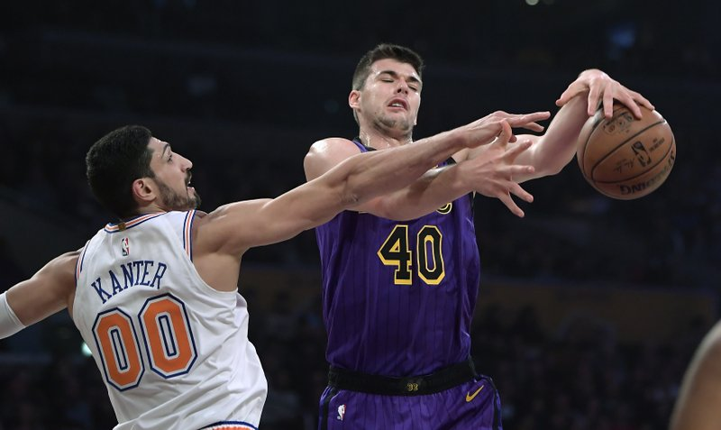 New York Knicks center Enes Kanter, left, blocks the shot of Los Angeles Lakers center Ivica Zubac during the first half of an NBA basketball game Friday, Jan. (AP Photo/Mark J. Terrill)