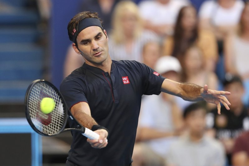 Switzerland's Roger Federer plays a shot against Alexander Zverev of Germany in their final match at the Hopman Cup tennis tournament in Perth, Australia, Saturday Jan. (AP Photo/Trevor Collens)