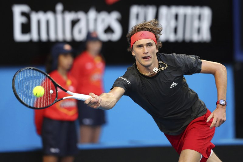 Alexander Zverev of Germany plays a forehand shot during his match against Switzerland's Roger Federer in the final of the Hopman Cup tennis tournament in Perth, Australia, Saturday Jan. (AP Photo/Trevor Collens)