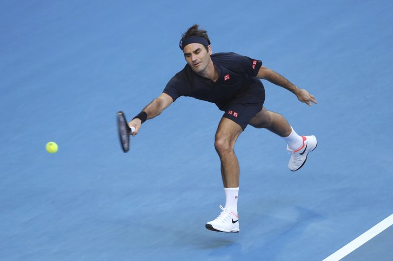 Switzerland's Roger Federer plays a shot during his match against Alexander Zverev of Germany in the final of the Hopman Cup tennis tournament in Perth, Australia, Saturday Jan. (AP Photo/Trevor Collens)