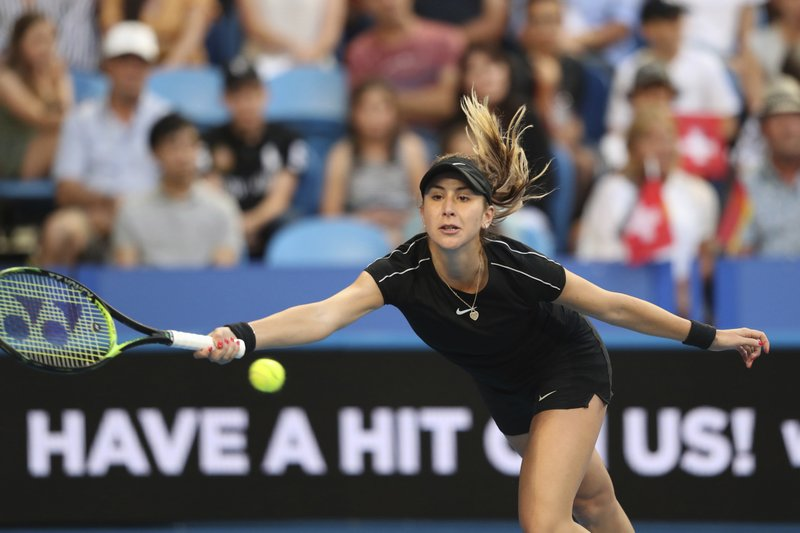 Switzerland's Belinda Bencic plays a shot during her match against Angelique Kerber of Germany in the final of the Hopman Cup tennis tournament in Perth, Australia, Saturday Jan. (AP Photo/Trevor Collens)