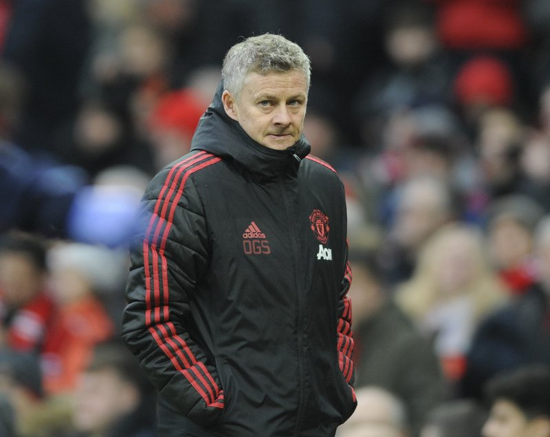 Manchester United manager Ole Gunnar Solskjær looks on during the English FA Cup third round soccer match between Manchester United and Reading at Old Trafford in Manchester, England, Saturday, Jan. (AP Photo/Rui Vieira)