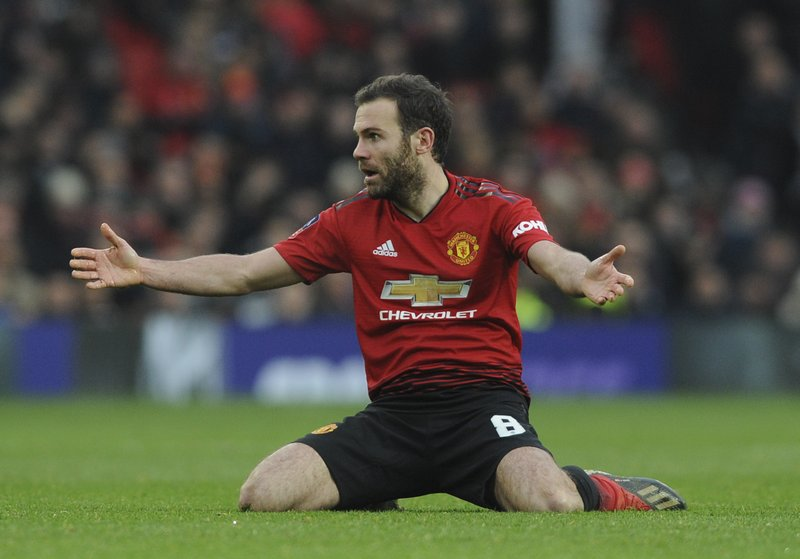 Manchester United's Juan Mata reacts during the English FA Cup third round soccer match between Manchester United and Reading at Old Trafford in Manchester, England, Saturday, Jan. (AP Photo/Rui Vieira)