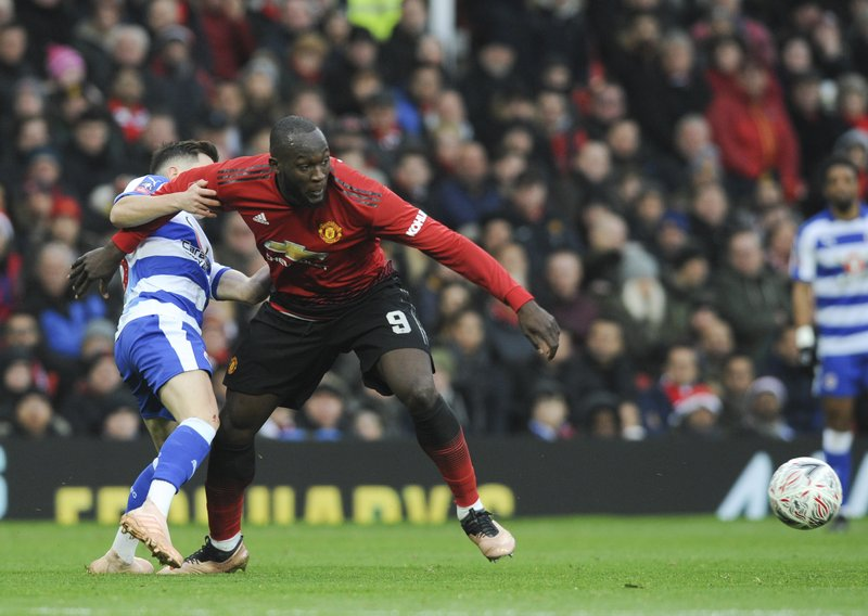 Manchester United's Romelu Lukaku challenge for the ball with Reading's player during the English FA Cup third round soccer match between Manchester United and Reading at Old Trafford in Manchester, England, Saturday, Jan. (AP Photo/Rui Vieira)