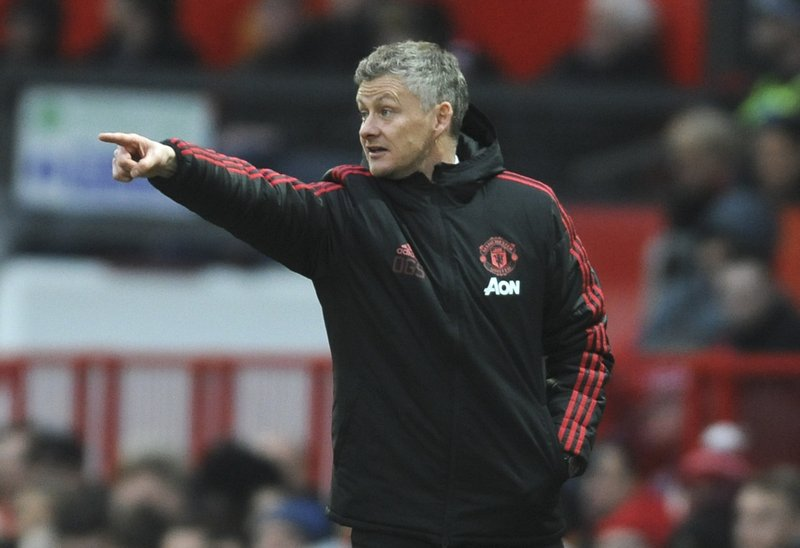 Manchester United manager Ole Gunnar Solskjær gives instructions during the English FA Cup third round soccer match between Manchester United and Reading at Old Trafford in Manchester, England, Saturday, Jan. (AP Photo/Rui Vieira)