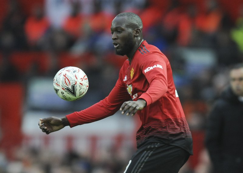Manchester United's Romelu Lukaku challenge for the ball during the English FA Cup third round soccer match between Manchester United and Reading at Old Trafford in Manchester, England, Saturday, Jan. (AP Photo/Rui Vieira)