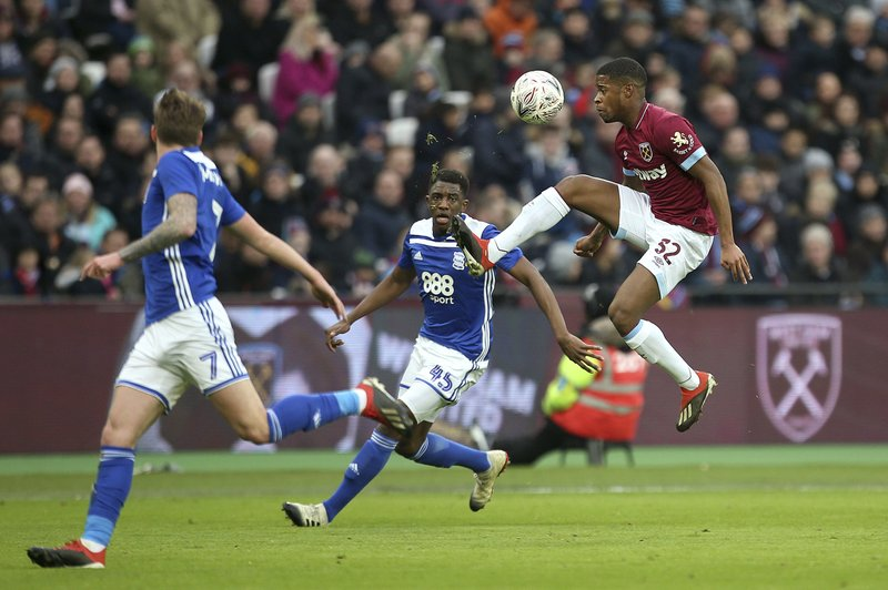West Ham United's Xande Silva, right, in action with Birmingham City's Wes Harding during the English FA Cup, third round soccer match at London Stadium, England, Saturday Jan. (Steven Paston/PA via AP)