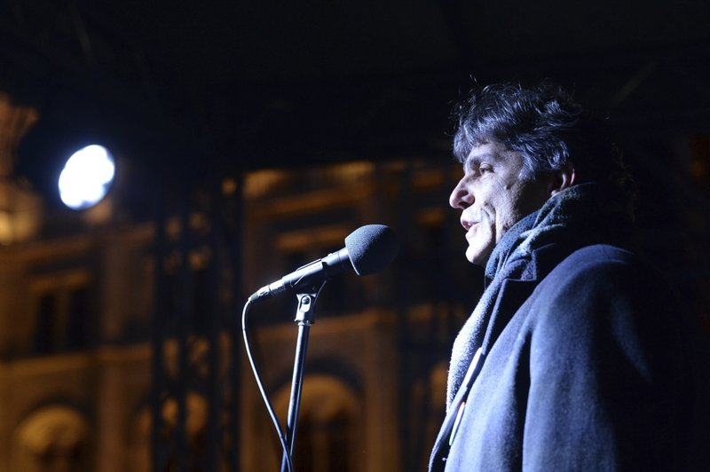 President of the Democratic Union of Teachers (PDSZ) Tamas Szucs delivers his speech during the anti-government demonstration in front of the Parliament building at Kossuth square, donwtown Budapest, Hungary, Saturday, Jan. (Zoltan Balogh/MTI via AP)