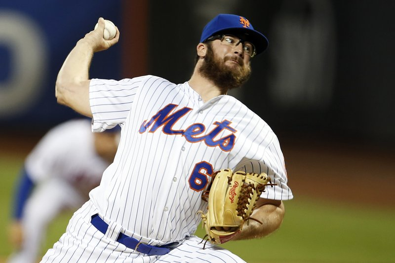 FILE - In this Aug. 4, 2018, file photo, New York Mets pitcher Bobby Wahl delivers during the eighth inning of a baseball game against the Atlanta Braves in New York. (AP Photo/Adam Hunger, File)