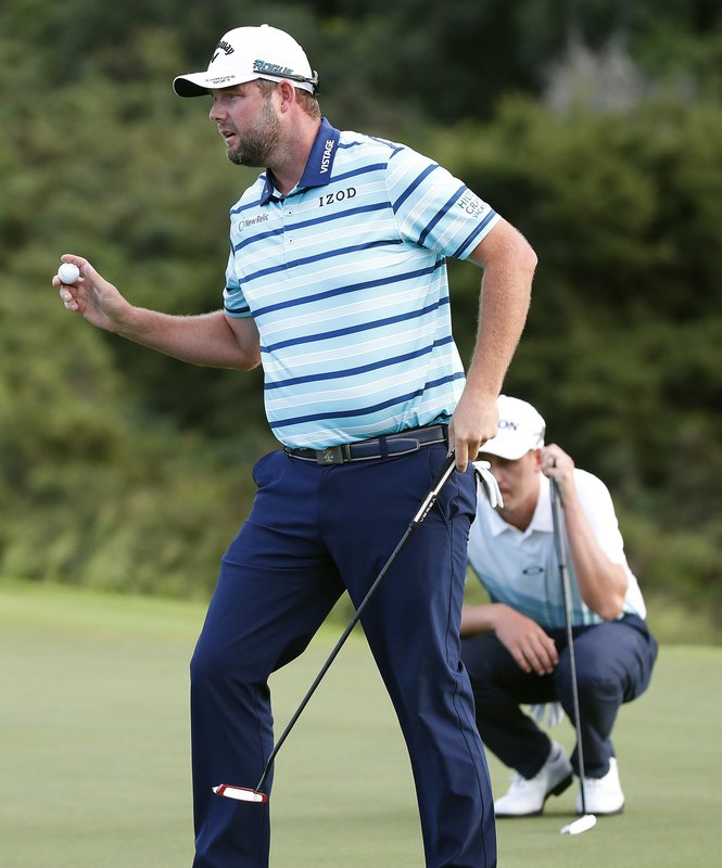 Marc Leishman waves after making his birdie putt on the 18th green during the second round of the Tournament of Champions golf event, Friday, Jan. (AP Photo/Matt York)