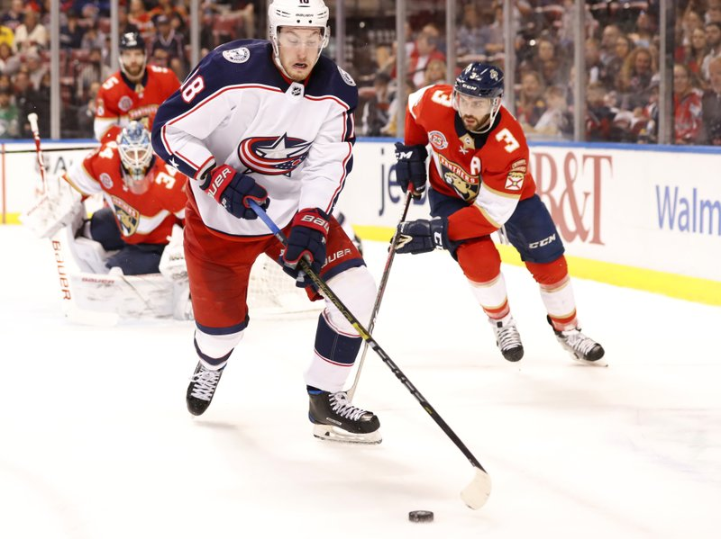 Columbus Blue Jackets center Pierre-Luc Dubois (18) skates against Florida Panthers defenseman Keith Yandle (3) during the first period of an NHL hockey game, Saturday, Jan. (AP Photo/Wilfredo Lee)