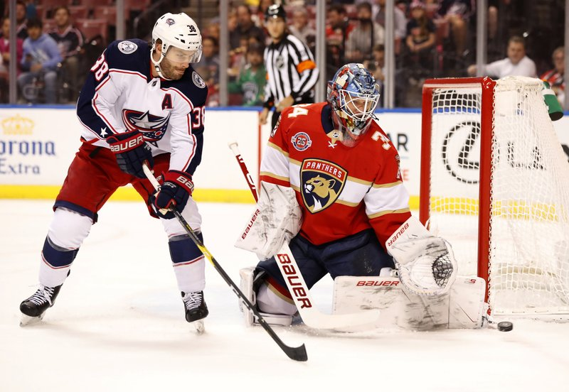 Columbus Blue Jackets center Boone Jenner (38) takes a shot against Florida Panthers goaltender James Reimer (34) during the first period of an NHL hockey game, Saturday, Jan. (AP Photo/Wilfredo Lee)