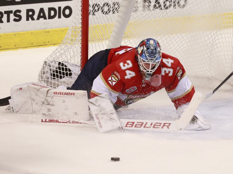 Florida Panthers goaltender James Reimer (34) deflects a shot during the second period of an NHL hockey game against the Columbus Blue Jackets, Saturday, Jan. (AP Photo/Wilfredo Lee)