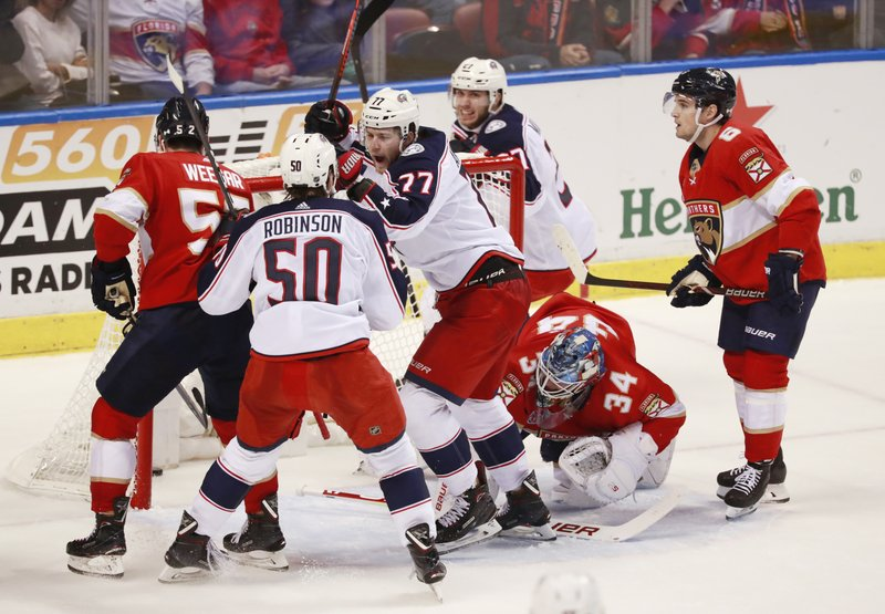 Columbus Blue Jackets right wing Josh Anderson (77) celebrates with left wing Eric Robinson (50) after Anderson scored during the second period of an NHL hockey game against the Florida Panthers, Saturday, Jan. (AP Photo/Wilfredo Lee)