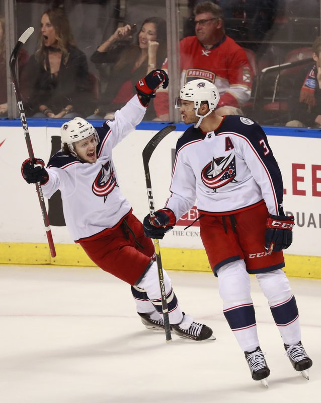 Columbus Blue Jackets left wing Artemi Panarin, left, congratulates defenseman Seth Jones (3) after Jones score a goal during an overtime period of an NHL hockey game against the Florida Panthers, Saturday, Jan. (AP Photo/Wilfredo Lee)