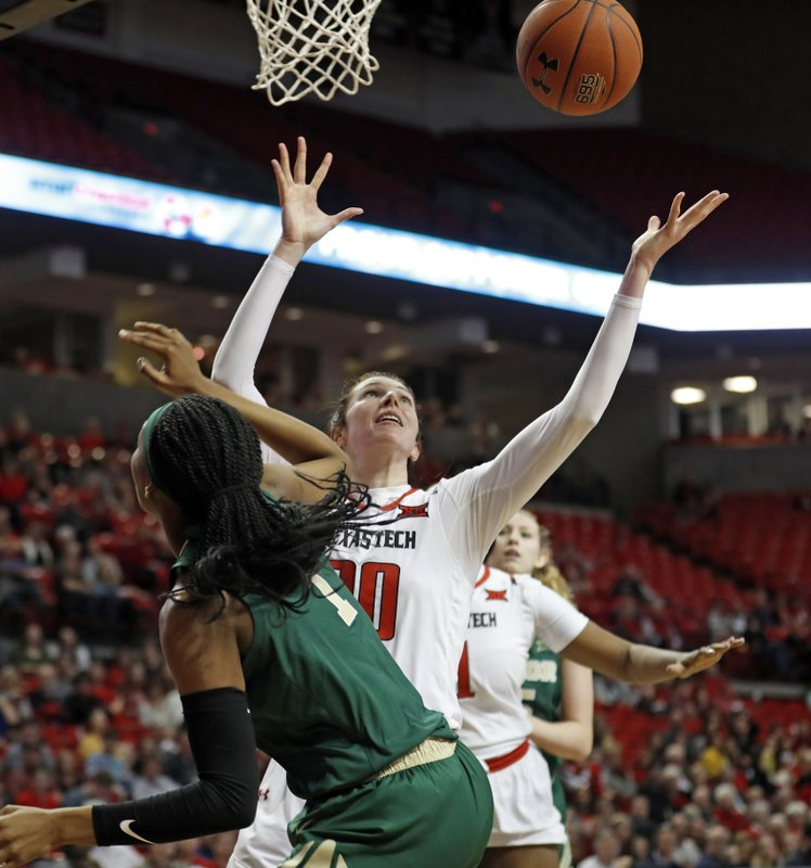 Texas Tech's Brittany Brewer (20) rebounds a shot by Baylor's NaLyssa Smith (1) she blocked  during the second half of an NCAA college basketball game Sunday, Jan. (Brad Tollefson/Lubbock Avalanche-Journal via AP)