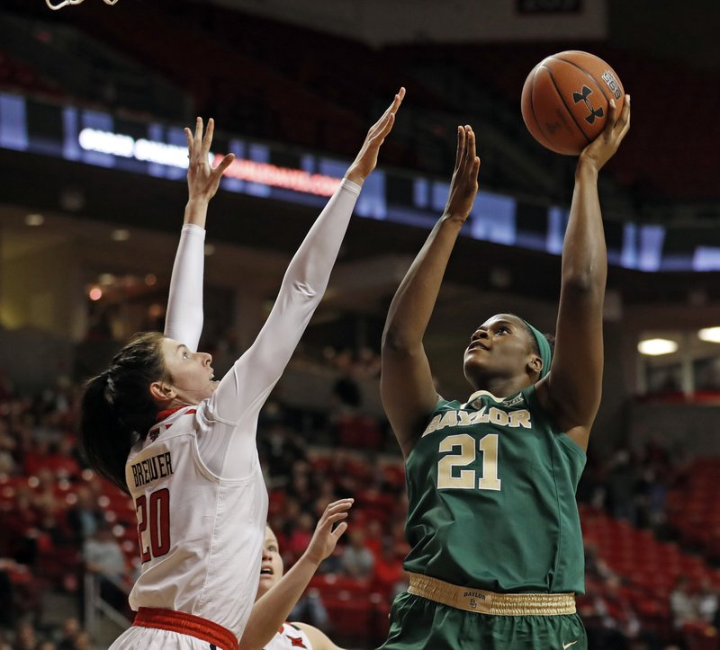 Baylor's Kalani Brown (21) shoots over Texas Tech's Brittany Brewer (20) during the second half of an NCAA college basketball game Sunday, Jan. (Brad Tollefson/Lubbock Avalanche-Journal via AP)