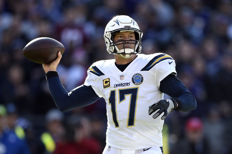 Los Angeles Chargers quarterback Philip Rivers throws a pass in the first half of an NFL wild card playoff football game against the Baltimore Ravens, Sunday, Jan. (AP Photo/Gail Burton)