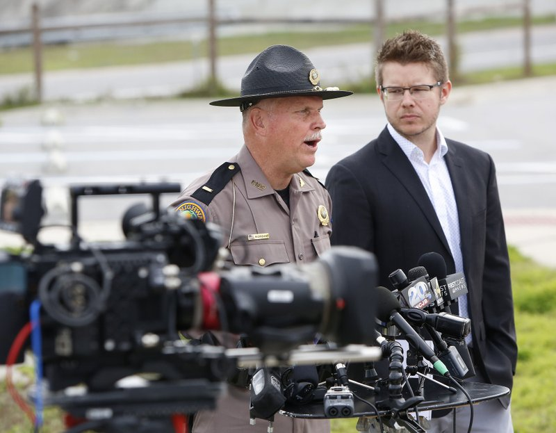 Florida Highway Patrol Lt. Pat Riordan, left, along with Troy Roberts, the spokesperson for the Florida Department of Transportation,  updates members the media during a press conference, Friday, Jan. (Brad McClenny/The Gainesville Sun via AP)