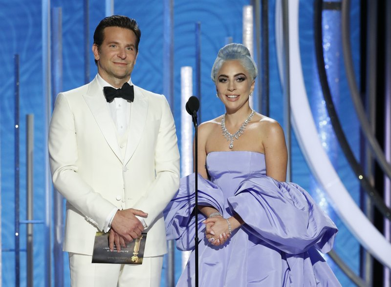 This image released by NBC shows Bradley Cooper, left, and Lady Gaga presenting the award for best actor in a TV comedy series at the 76th Annual Golden Globe Awards at the Beverly Hilton Hotel on Sunday, Jan. (Paul Drinkwater/NBC via AP)